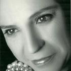 Dra. Regina Isa Ramos de Toledo (Cirurgiã-Dentista)