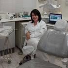 Dra. Maria Theresa de Portilho Lopes Khusala (Cirurgiã-Dentista)